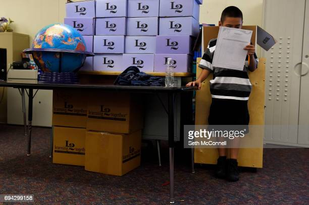 Marcello Mendez looks over a questionnaire at North Star Elementary School on June 5 in Thornton Colorado Adams 12 Five Star Schools offers free...