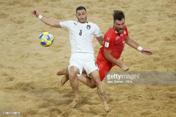 Marcello Percia Montani of Italy is challenged by Philipp Borer of Switzerland during the FIFA Beach Soccer World Cup Paraguay 2019 quarterfinal...