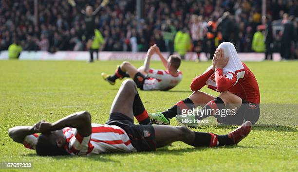 Marcello Trotta of Brentford hold his head in his hands after missing a last minute penalty that would have given his team automatic promotion during...