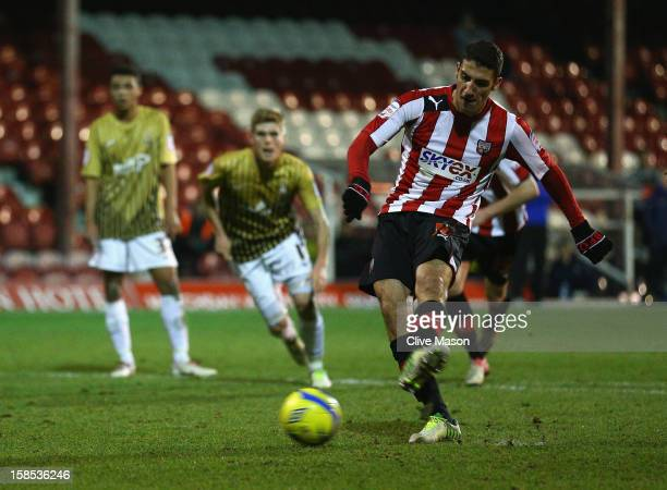 Marcello Trotta of Brentford shoots and scores a penalty during the FA Cup with Budweiser Second Round replay match between Brentford and Bradford...