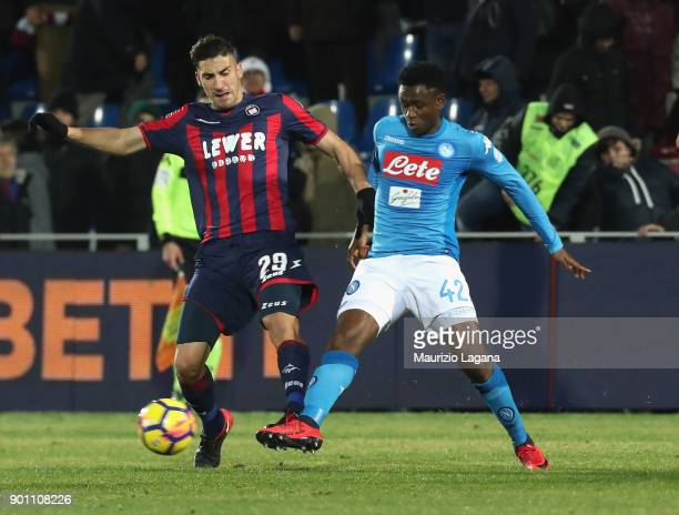 Marcello Trotta of Crotone competes for the ball with Amadou Diawara of Napoli during the serie A match between FC Crotone and SSC Napoli at Stadio...