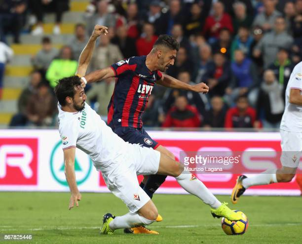 Marcello Trotta of Crotone competes for the ball with Davide Astori of Fiorentina during the Serie A match between FC Crotone and ACF Fiorentina at...