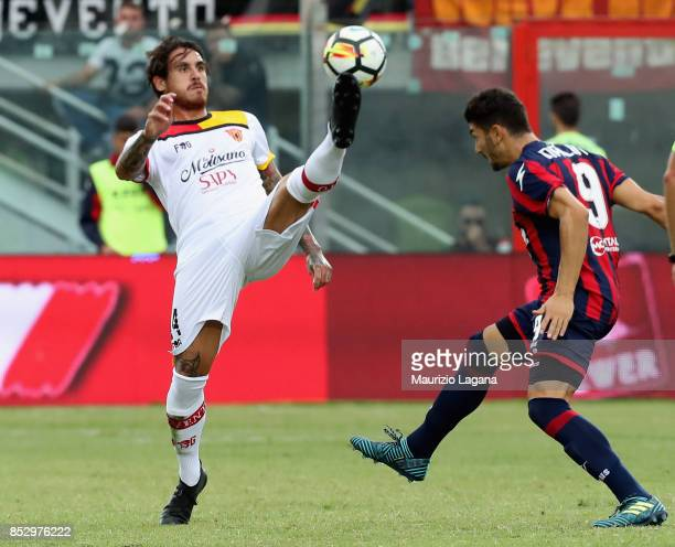 Marcello Trotta of Crotone competes for the ball with Nicolas Viola of Benevento during the Serie A match between FC Crotone and Benevento Calcio at...