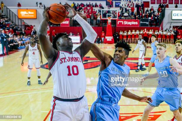Marcellus Earlington of the St. John's Red Storm attempts a shot against Randy Brumant of the Columbia Lions at Carnesecca Arena on November 20, 2019...