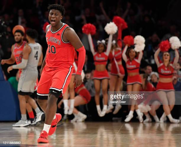 Marcellus Earlington of the St. John's Red Storm reacts after scoring in the second half against the Georgetown Hoyas during the first round of the...