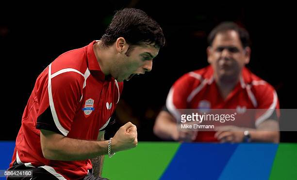 Marcelo Aguirre of Paraguay plays a Men's Singles preliminary match against David Powell of Australia on Day 1 of the Rio 2016 Olympic Games at...