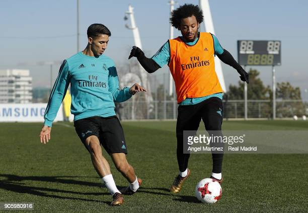 Marcelo and Achraf Hakimi of Real Madrid in action during a training session at Valdebebas training ground on January 17 2018 in Madrid Spain