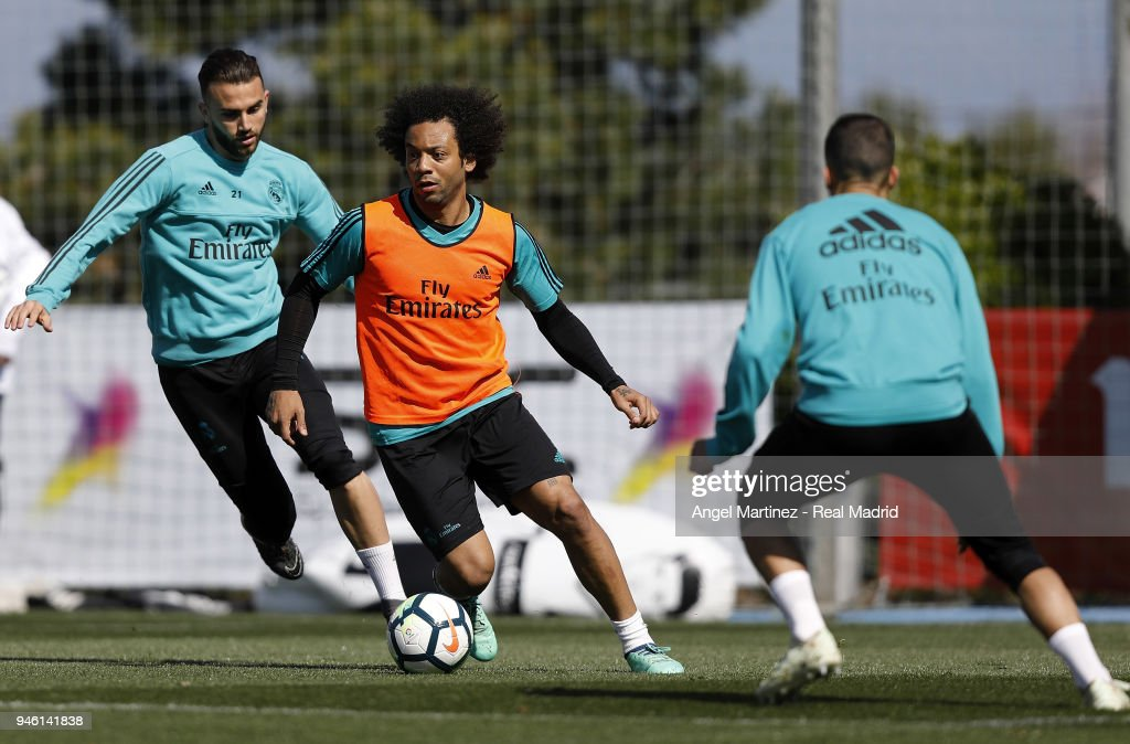Marcelo (C) and Borja Mayoral of Real Madrid in action during a training session at Valdebebas training ground on April 14, 2018 in Madrid, Spain.
