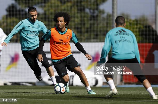 Marcelo and Borja Mayoral of Real Madrid in action during a training session at Valdebebas training ground on April 14 2018 in Madrid Spain