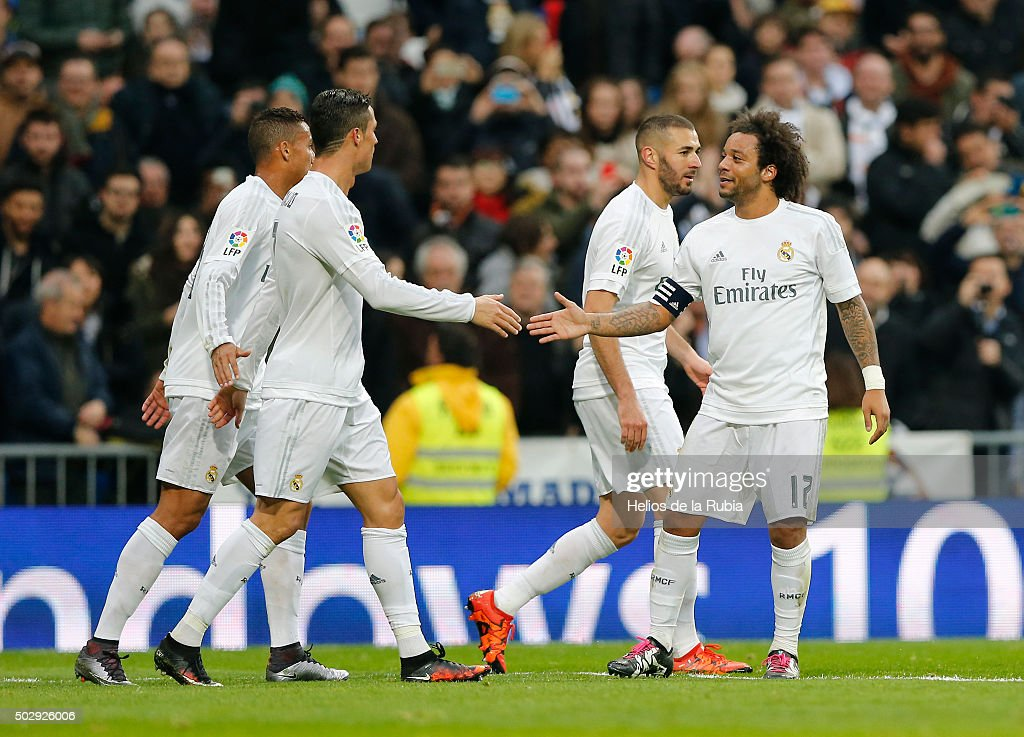 Marcelo and Cristiano Ronaldo (L) of Real Madrid celebrate after scoring during the La Liga match between Real Madrid CF and Real Sociedad at Estadio Santiago Bernabeu on December 30, 2015 in Madrid, Spain.