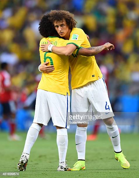Marcelo and David Luiz of Brazil hug at the start of the 2014 FIFA World Cup Brazil Quarter Final match between Brazil and Colombia at Castelao on...