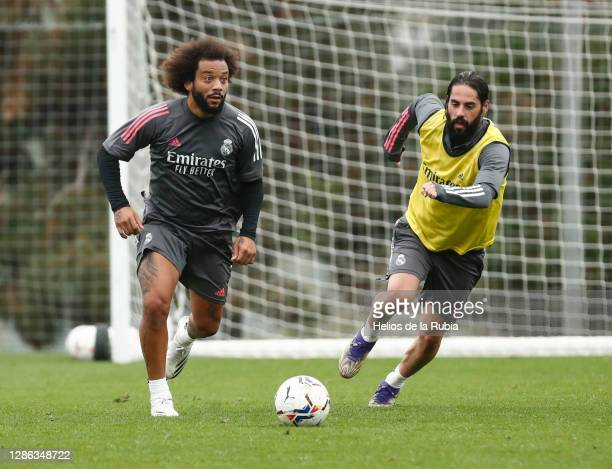 Marcelo and Isco in action at Valdebebas training ground on November 18, 2020 in Madrid, Spain.