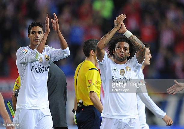Marcelo and Rafael Varane of Real Madrid applaud Real fans after they drew 11 in the La Liga match between Club Atletico de Madrid and Real Madrid at...