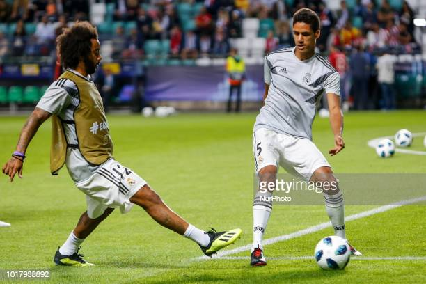Marcelo and Raphael Varane of Real Madrid during the warmup ahead of the UEFA Super Cup match between Real Madrid and Atletico Madrid on August 15...