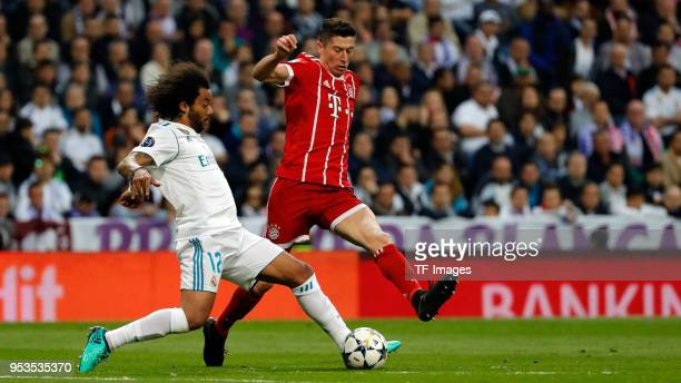Marcelo and Robert Lewandowski of Bayern Muenchen battle for the ball during the UEFA Champions League Semi Final Second Leg match between Real...