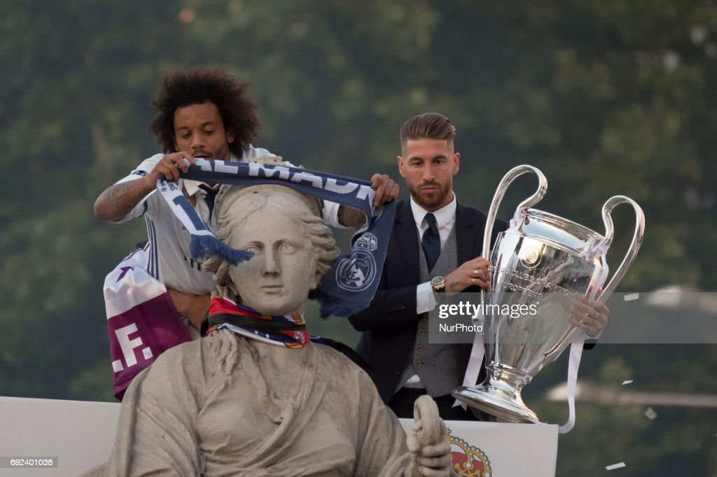 Marcelo and Sergio Ramos attends a celebrations at the Plaza Cibeles after Real Madrid won the 2016/17 UEFA Champions League, in Madrid on June 4, 2017. Real Madrid team celebrate with the supporters the victory against Juventus in the UEFA Champions League Champions League