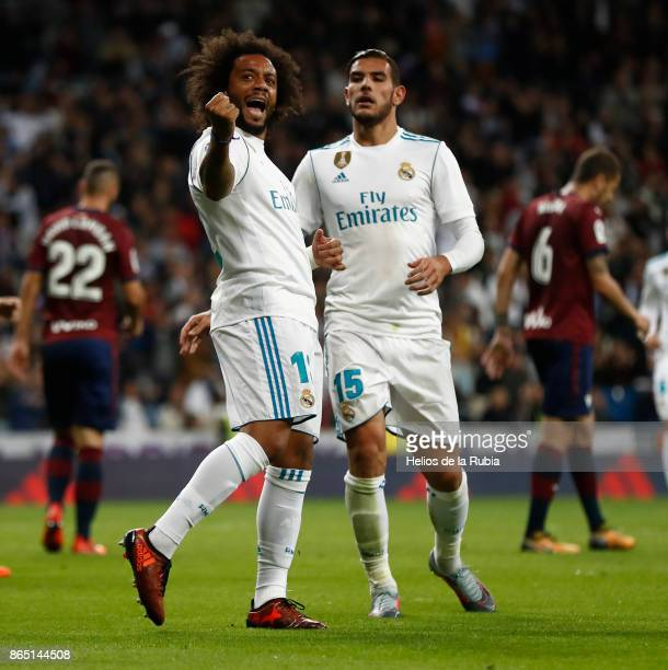 Marcelo and Theo Hernandez of Real Madrid celebrates after scoring during the La Liga match between Real Madrid and Eibar at Estadio Santiago...