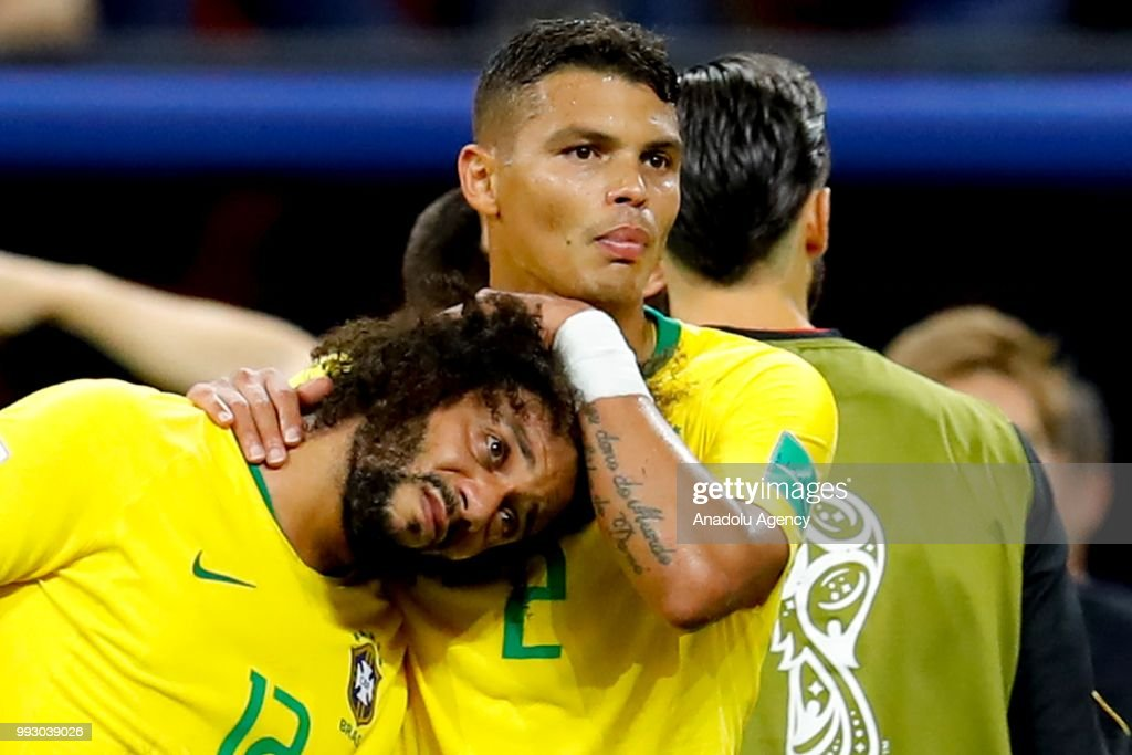 Marcelo (12) and Thiago Silva (R) of Brazil react after losing the 2018 FIFA World Cup Russia quarter final match between Brazil and Belgium at the Kazan Arena in Kazan, Russia on July 06, 2018.