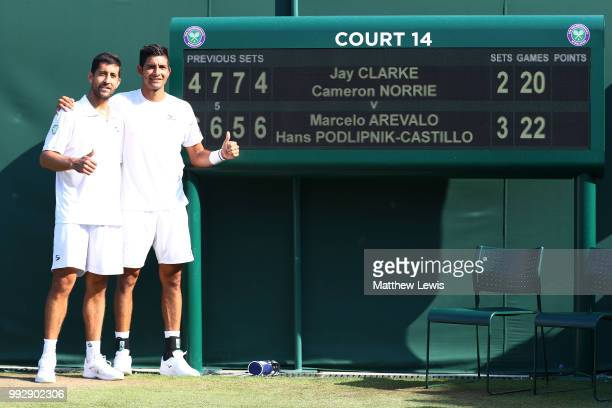 Marcelo Arevalo of El Salvador and Hans Podlipnik-Castillo of Chile pose after defeating Jay Clarke and Cameron Norrie of Great Britain in their...
