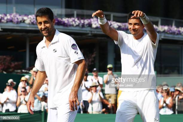 Marcelo Arevalo of El Salvador and Hans Podlipnik-Castillo of Chile celebrates after defeating Jay Clarke and Cameron Norrie of Great Britain in...