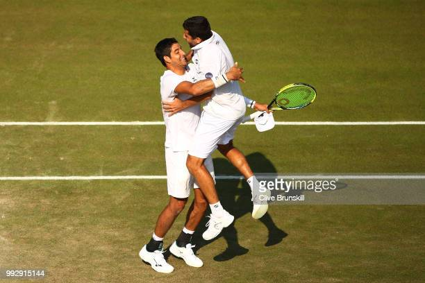 Marcelo Arevalo of El Salvador and Hans Podlipnik-Castillo of Chile celebrate after defeating Jay Clarke and Cameron Norrie of Great Britain in their...