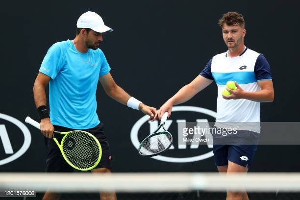 Marcelo Arevalo of El Salvador and Jonny O'Mara of Great Britain celebrate a point in their Men's Doubles second round match against Jurgen Melzer of...
