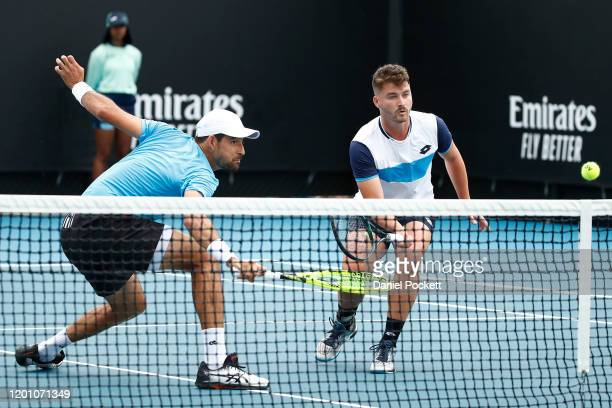 Marcelo Arevalo of El Salvador and Jonny O'Mara of Great Britain play during their Men's Doubles first round match against Hugo Dellien of Bolivia...