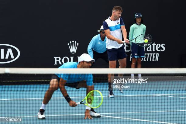 Marcelo Arevalo of El Salvador and Jonny O'Mara of Great Britain play in their Men's Doubles second round match against Jurgen Melzer of Austria and...