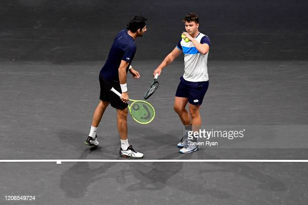 Marcelo Arevalo of El Salvador and Jonny O'Mara of Great Britain discuss the point during their Men's Double's semifinal match against Steve Johnson...