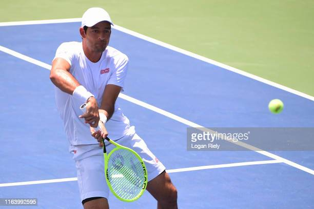 Marcelo Arevalo of El Salvador returns a backhand to Frances Tiafoe and Nicholas Monroe during the BB&T Atlanta Open at Atlantic Station on July 24,...