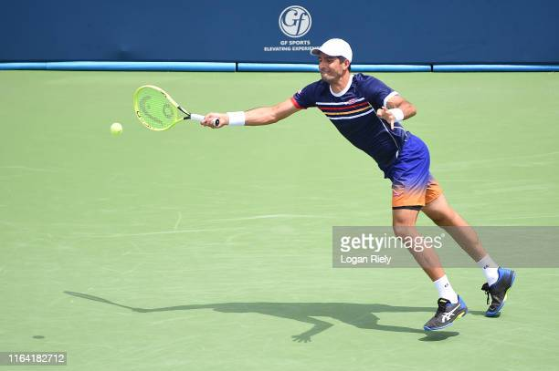 Marcelo Arevalo of El Salvador returns a forehand to Radu Albot of Moldova and Artem Sitak of New Zealand during the BB&T Atlanta Open at Atlantic...