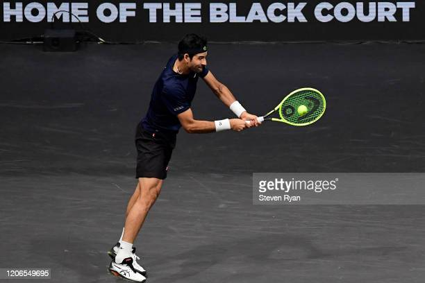 Marcelo Arevalo of El Salvador returns a shot during his Men's Double's semifinal match against Steve Johnson and Reilly Opelka of the United States...