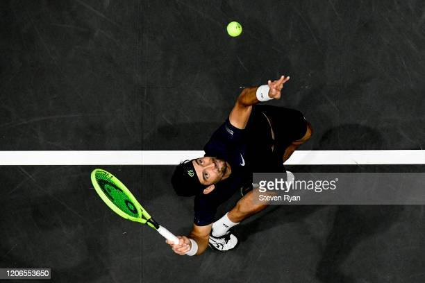 Marcelo Arevalo of El Salvador serves the ball during his Men's Double's semifinal match against Steve Johnson and Reilly Opelka of the United States...