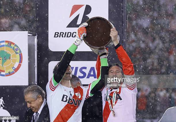 Marcelo Barovero and Fernando Cavenaghi of River Plate lift the trophy after winning a second leg final match between River Plate and Tigres UANL as...