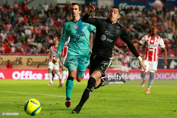 Marcelo Barovero goalkeeper of Necaxa fights for the ball with Rogelio Funes Mori of Monterrey during the 8th round match between Necaxa and...