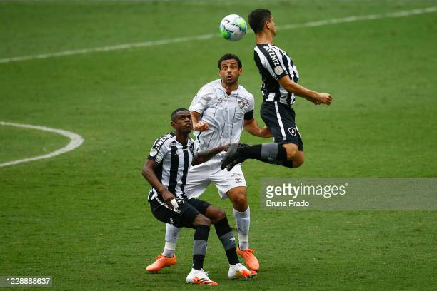 Marcelo Benevenuto of Botafogo fights for the ball with Fred and Kevin of Fluminense during the match between Botafogo and Fluminense as part of the...