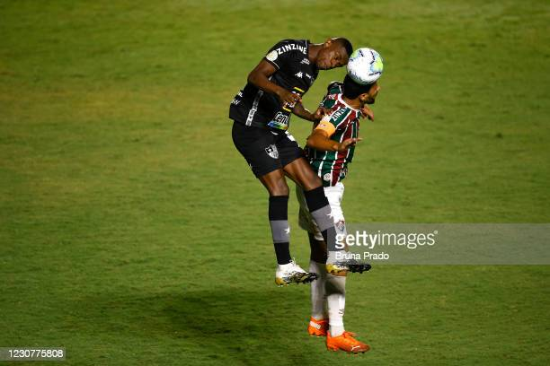 Marcelo Benevenuto of Botafogo heads the ball with Nene of Fluminense during the match between Fluminense and Botafogo as part of the Brasileirao...