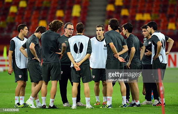 Marcelo Bielsa coach of Athletic Bilbao talks to players during the Athletic Bilbao training session ahead of the UEFA Europa League Final between...