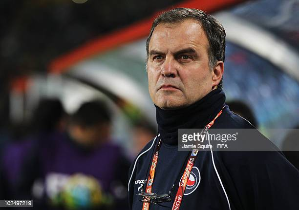 Marcelo Bielsa head coach of Chile looks on ahead of the 2010 FIFA World Cup South Africa Round of Sixteen match between Brazil and Chile at Ellis...