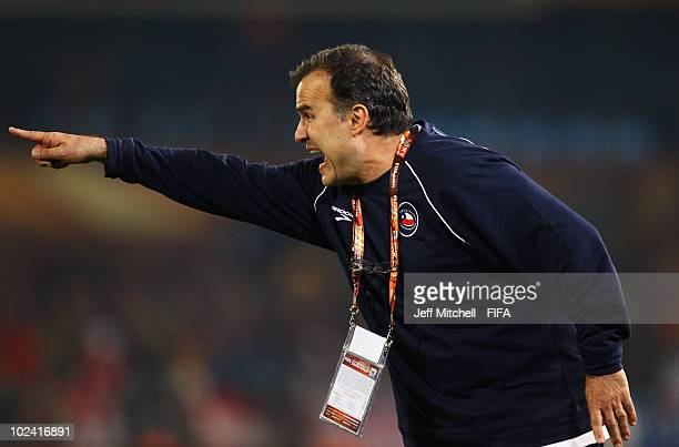 Marcelo Bielsa head coach of Chile shouts instructions to his players during the 2010 FIFA World Cup South Africa Group H match between Chile and...