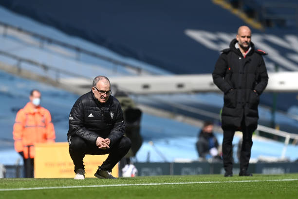 Marcelo Bielsa, Manager of Leeds United and Pep Guardiola, Manager of Manchester City look on during the Premier League match between Manchester City...