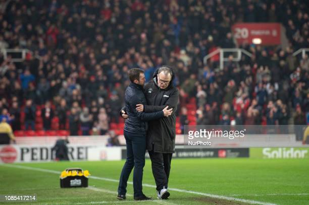 Marcelo Bielsa manager of Leeds United congratulates Nathan Jones manager of Stoke City after the Sky Bet Championship match between Stoke City and...