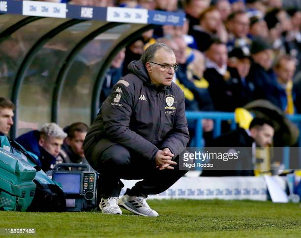 Marcelo Bielsa manager of Leeds United crouches during the Sky Bet Championship match between Leeds United and Cardiff City at Elland Road on...