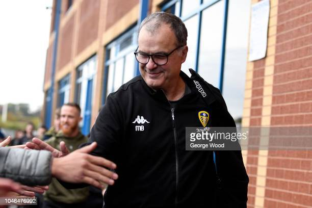 Marcelo Bielsa manager of Leeds United greet fans as he arrives at the stadium prior to the Sky Bet Championship match between Leeds United and...