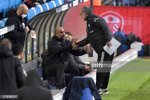 Marcelo Bielsa, Manager of Leeds United greets Pep Guardiola, Manager of Manchester City prior to the Premier League match between Leeds United and...
