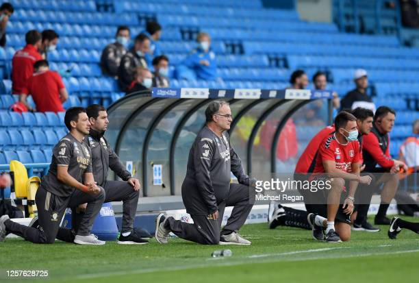 Marcelo Bielsa, Manager of Leeds United takes a knee in support of the Black Lives Matter movement during the Sky Bet Championship match between...
