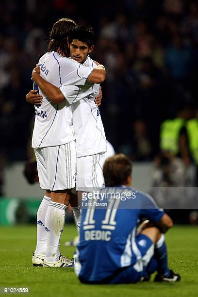 Marcelo Bordon and Carlos Zambrano of Schalke celebrate after winning the DFB Cup second round match between VfL Bochum and FC Schalke 04 at...