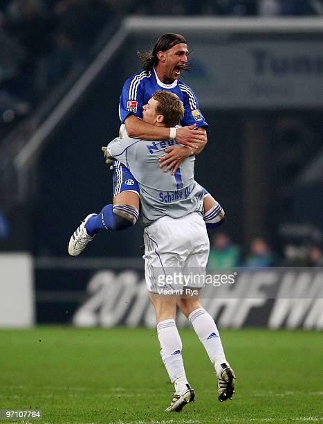 Marcelo Bordon and goalkeeper Manuel Neuer of Schalke celebrate a goal scored by his team mate Ivan Rakitic during the Bundesliga match between FC...