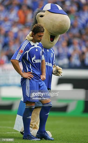Marcelo Bordon of Schalke looks sad as mascot Erwin consoles him during the Bundesliga match between Schalke 04 and Arminia Bielefeld at the Veltins...