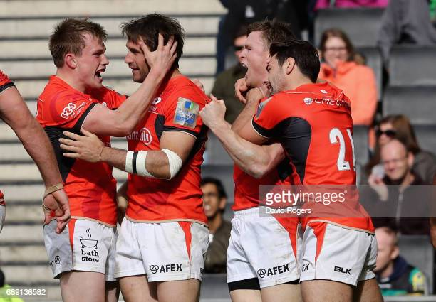 Marcelo Bosch of Saracens is mobbed by team mates after scoring the last minute try during the Aviva Premiership match between Northampton Saints and...